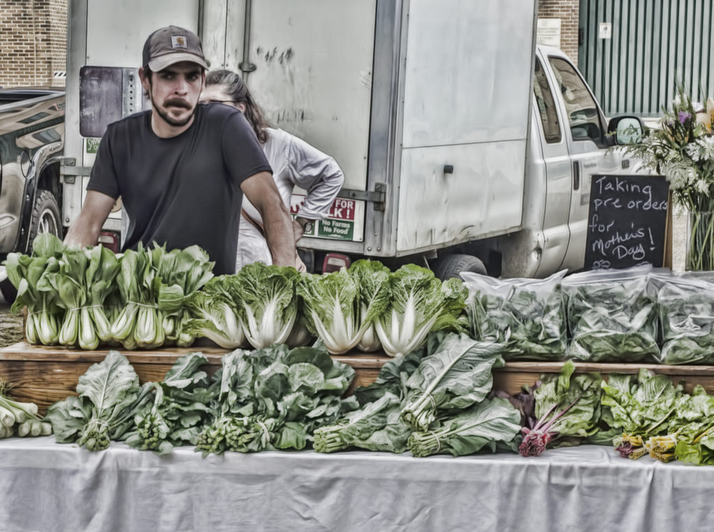 Farmer selling at Farmer's Market